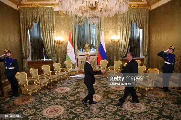 Russian President Vladimir Putin greets Tajik President Emomali Rakhmon during their bilateral meeting at the Grand Kremlin Palace, on April 17, 2019...