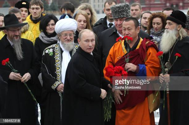 Russian President Vladimir Putin greets the leaders of the country's main religions as he attends a ceremony to mark National Unity Day at Red Square...