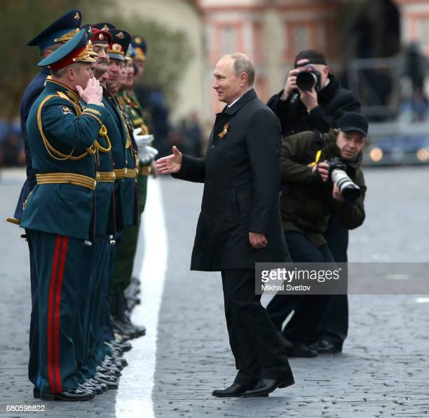 Russian President Vladimir Putin greets the military as he attends the Victory Day military parade to celebrate the 72nd anniversary of the victory...