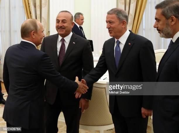 Russian President, Vladimir Putin greets Turkish national defence minister, Hulusi Akar , Turkish foreign minister, Mevlut Cavusoglu and Turkish...