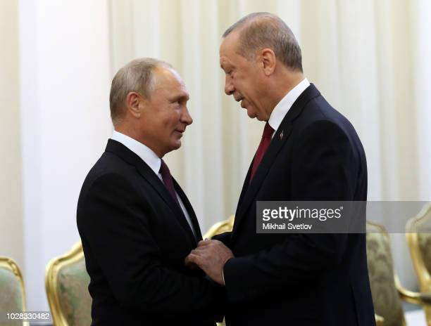 Russian President Vladimir Putin greets Turkish President Tayyip Recep Erdogan during their meeting prior to the Trilateral Summit Iran-Russia-Turkey...