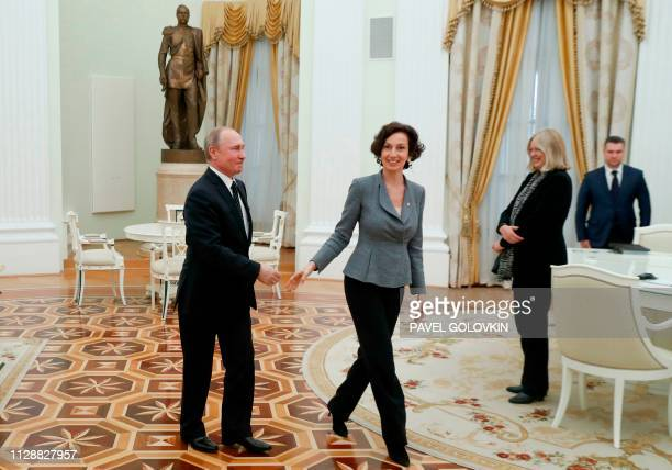 Russian President Vladimir Putin greets UNESCO'S DirectorGeneral Audrey Azoulay during their meeting at the Kremlin in Moscow on March 6 2019