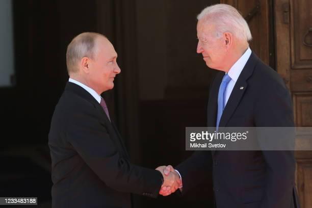 Russian President Vladimir Putin greets US President Joe Biden during the US - Russia Summit 2021 at the La Grange Villa near the Geneva Lake, on...