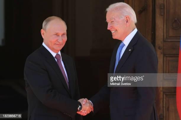 Russian President Vladimir Putin greets US President Joe Biden during the US - Russia Summit 2021 at the La Grange Villa near Lake Geneva, on June...