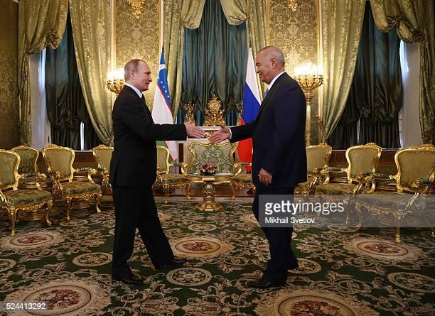 Russian President Vladimir Putin greets Uzbek President Islam Karimov during their meeting in the Grand Kremlin Palace on April 26 2016 in Moscow...