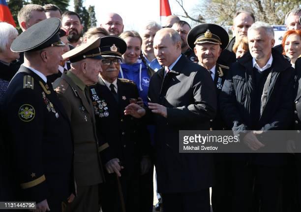 Russian President Vladimir Putin greets WWII veteran at the monument at Malakhov Hill March 18 2019 in Simferopol Crimea Russia Putin is having a...