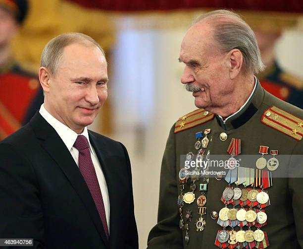 Russian President Vladimir Putin greets WWII veteran participant of the Stalingrad Battle Vladimir Ananyev during an award ceremony in which he gave...