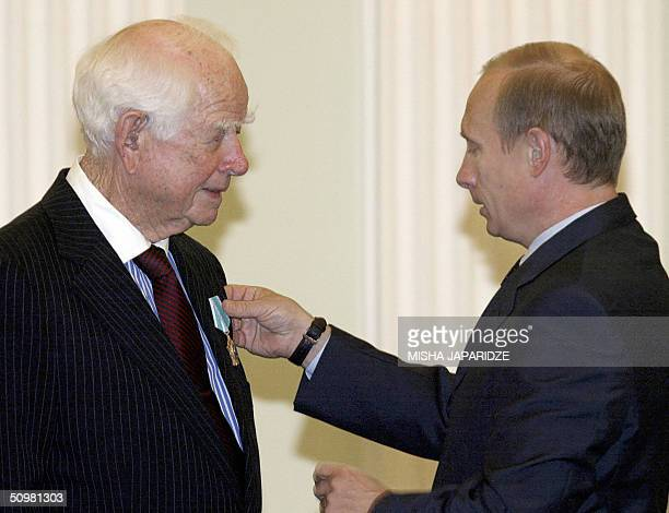 Russian President Vladimir Putin hands over an Order of Friendship to PepsiCo cofounder Donald Kendall at the Moscow's Kremlin 21 June 2004 The award...