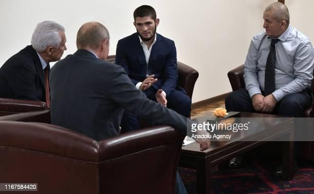 Russian President Vladimir Putin Head of the Republic of Dagestan Vladimir Vasilyev meet with Russian mixed martial artist UFC Lightweight Champion...
