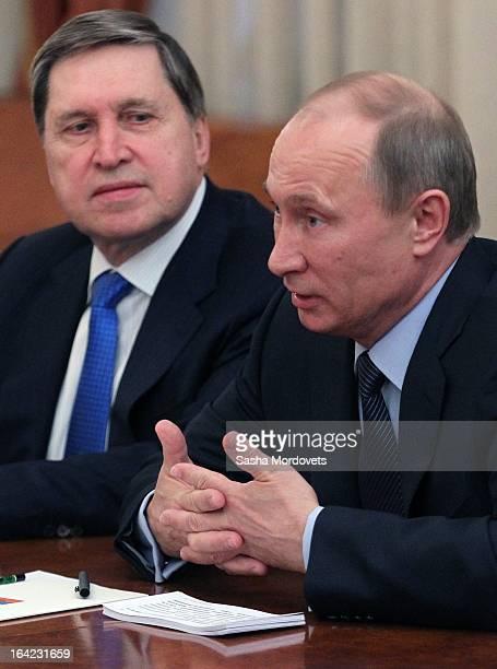 Russian President Vladimir Putin his Advisor Yuri Ushakov attend a meeting with EU Commission President Jose Manuel Barroso on March 21, 2013 in...