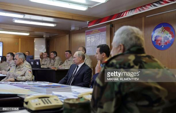 Russian President Vladimir Putin his Syrian counterpart Bashar alAssad and Russian Defence Minister Sergei Shoigu attend a meeting with Russian...