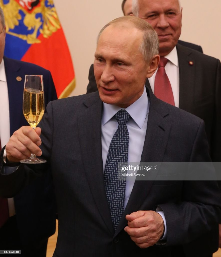 Russian President Vladimir Putin holds a glass of champaigne during a reception with the Rostec State Corporation CEO and workers to celebrate the 10th Anniversary of Rostec State Corporation at Novo Ograyovo State Residence on December 7, near Moscow, Russia. Mr Putin confirmed that he will run in the 2018 Presidential Elections during a meeting with workers of the GAZ plant yesterday.