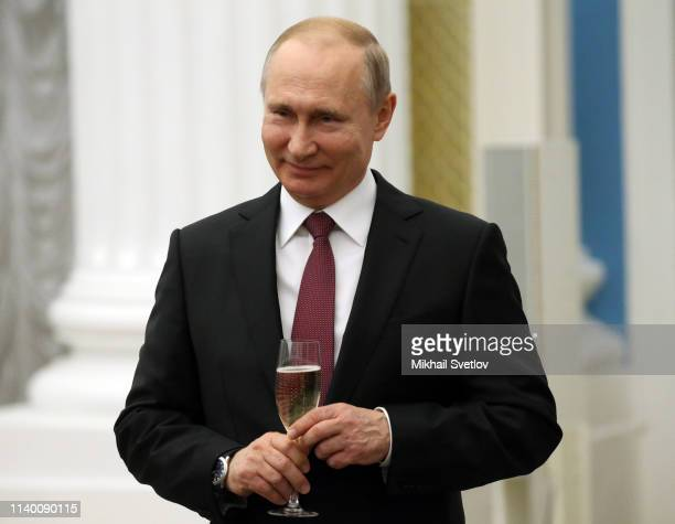 Russian President Vladimir Putin holds a glass of champaigne during the awarding ceremony at the Kremlin April 29, 2019 in Moscow, Russia. Putin gave...