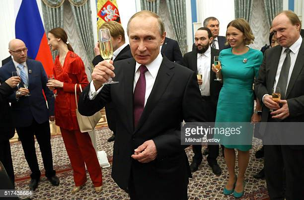 Russian President Vladimir Putin holds a glass of champaigne during the 2015 Russian Federation Presidential Prize for writing and art for children...