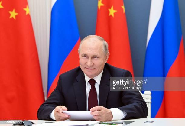Russian President Vladimir Putin holds a meeting via video conference with Chinese President Xi Jinping at the Kremlin in Moscow on June 28, 2021.