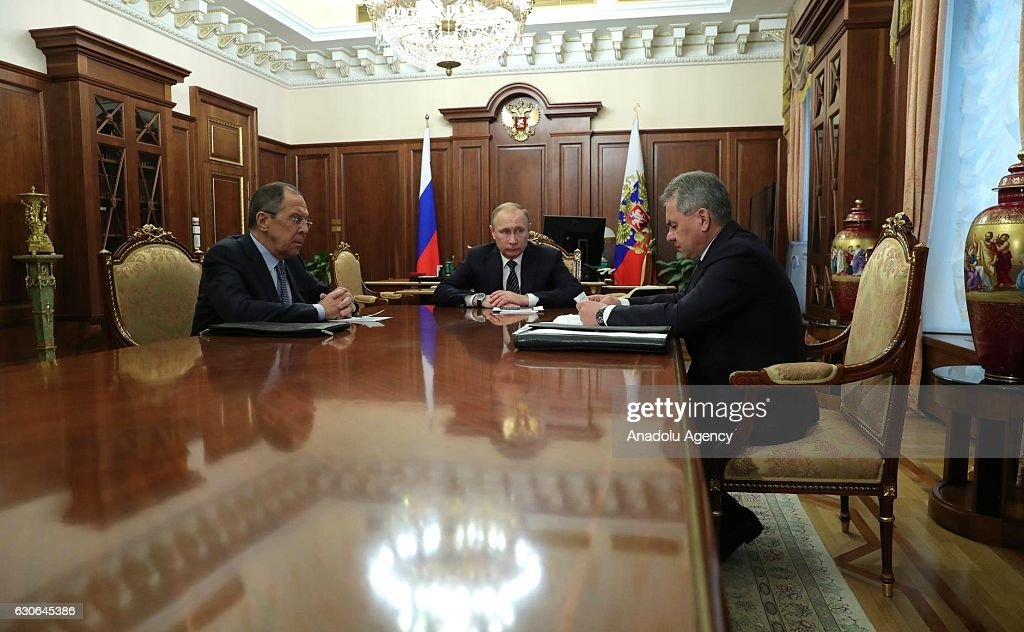 Russian President Vladimir Putin (C) holds a meeting with Russian Foreign Minister Sergey Lavrov (L) and Defense Minister Sergey Shoygu (R) in Moscow, Russia on December 29, 2016. Putin says cease-fire agreement in Syria reached under guarantee of Russia, Turkey.