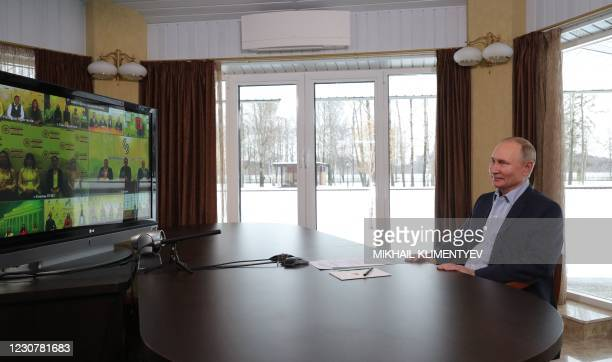 Russian President Vladimir Putin holds a meeting with Russian students via a videoconference at a residence in Zavidovo, Tver region, on the...