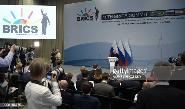Russian President Vladimir Putin holds a press conference at the end of the 10th BRICS summit on July 27 2018 in Johannesburg South Africa
