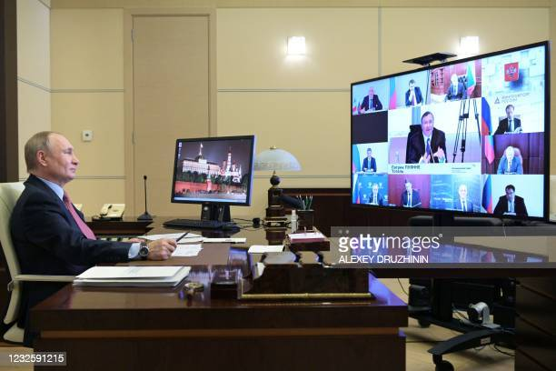 Russian President Vladimir Putin holds a video conference meeting with representatives of the French business community at the Novo-Ogaryovo state...