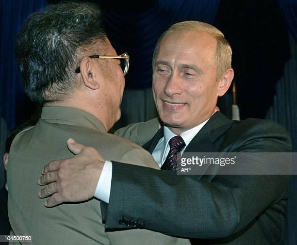 Russian President Vladimir Putin hugs North Korean leader Kim Jong Il during their meeting in the far eastern city of Vladivostok 23 August 2002...