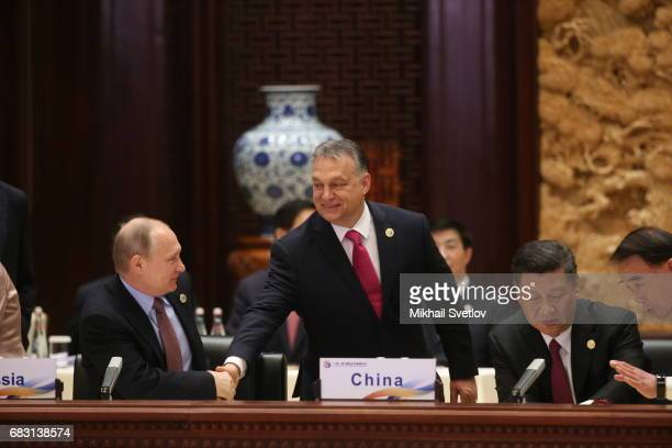 Russian President Vladimir Putin Hungarian President Viktor Orban and Chinese President Xi Jinping attend the roundtable plenary meeting during the...