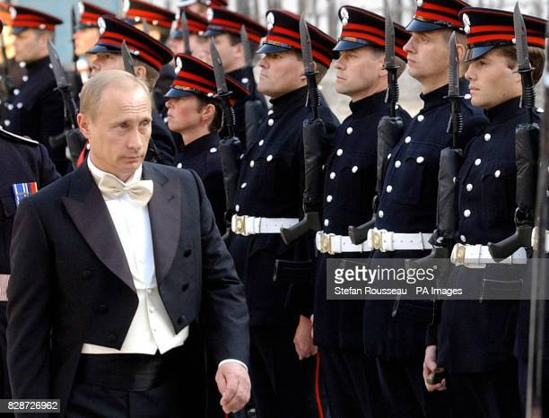 Russian President Vladimir Putin inspects an honour guard drawn from the Honourable Artillery Company at the Guildhall in London where the President...
