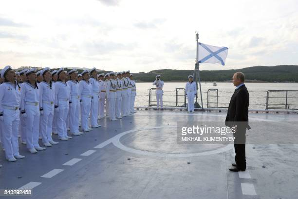 Russian President Vladimir Putin inspects sailors aboard the corvette Sovershenny of project 20380 moored at Ayaks Bay near Russky Island outside...
