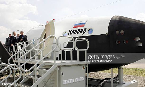 Russian President Vladimir Putin inspects the first mock-up of the new Russian reusable spacecraft Kliper during the first day of MAKS-2005...
