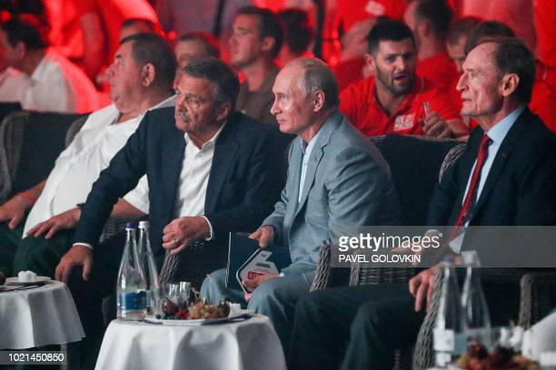 Russian President Vladimir Putin International Ice Hockey Federation President Rene Fasel and former chairman of the IOC Coordination Commission for...