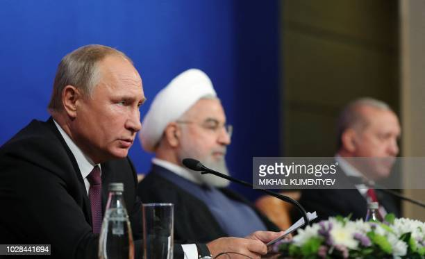 Russian President Vladimir Putin Iranian President Hassan Rouhani and Turkish President Recep Tayyip Erdogan attend a press conference after meeting...