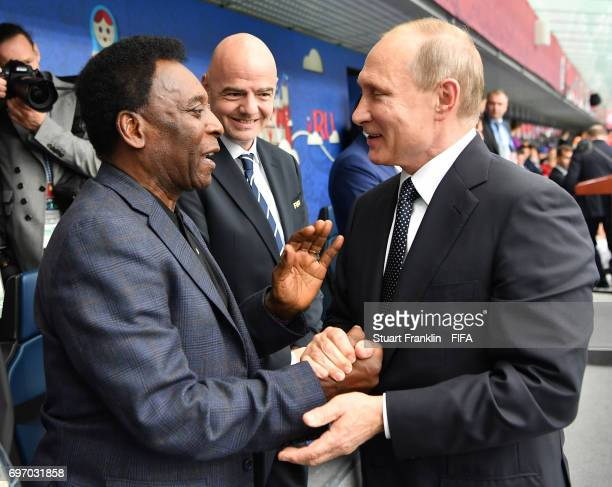 Russian President Vladimir Putin is greeted by Brazilian football legend Pele as FIFA president Gianni Infantino looks on prior to the FIFA...