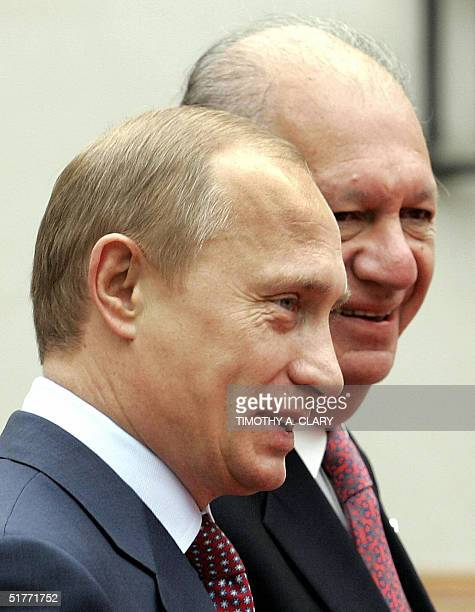 Russian President Vladimir Putin is greeted by Chilean President Ricardo Lagos as he arrives at the La Moneda Palace in Santiago Chile 21 November...