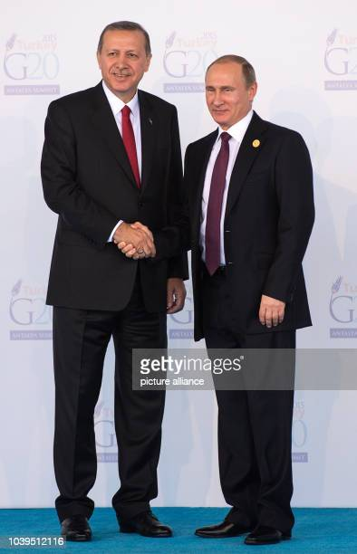 Russian President Vladimir Putin is greeted by Turkish President Recep Tayyip Erdogan the G20 summit of major industrialized and emerging countries...