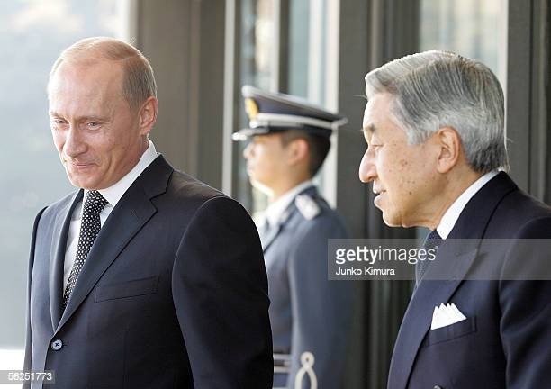 Russian President Vladimir Putin is led by Japanese Emperor Akihito upon his departure at the Imperial Palace on November 22 2005 in Tokyo Japan...
