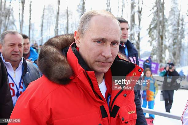 Russian President Vladimir Putin is seen on day eight of the Sochi 2014 Paralympic Winter Games at Laura Crosscountry Ski Biathlon Center on March 15...