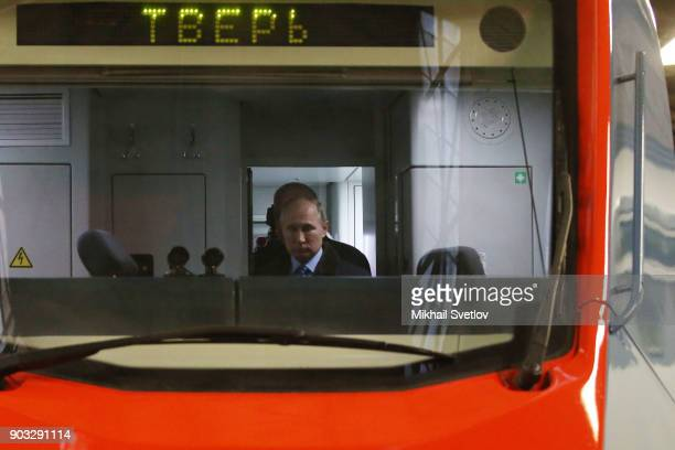Russian President Vladimir Putin is shown a new train at the Tver Carriage Works on January 10 2018 in Tver Russia Putin who is planning to be...