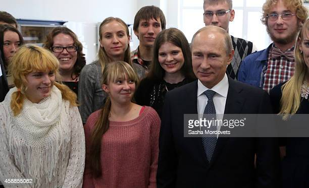 Russian President Vladimir Putin is surrounded by students during his visit to the Far Eastern Federal University on November 12 2014 in Vladivostok...