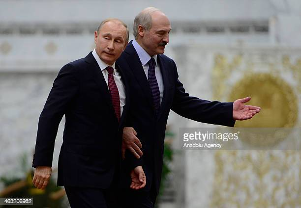 Russian President Vladimir Putin is welcomed by Belarus President Alexander Lukashenko ahead of the peace talks over the situation in Eastern Ukraine...