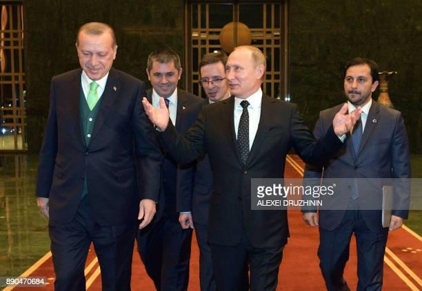 Russian President Vladimir Putin is welcomed by Turkish President Recep Tayyip Erdogan for a meeting in Ankara on December 11, 2017. Russian...