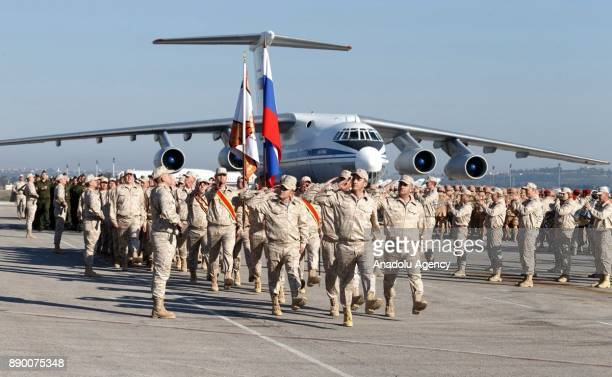 Russian President Vladimir Putin is welcomed with an official ceremony during his visit at Hmeymim base in Syria's Latakia on December 11 2017