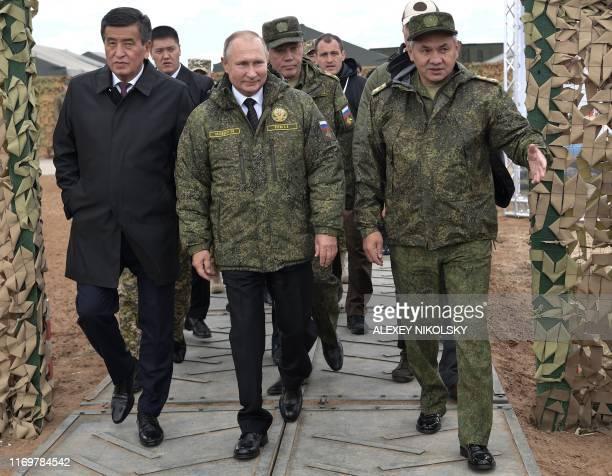 Russian President Vladimir Putin , Kyrgyz President Sooronbay Jeenbekov Russian Defence Minister Sergei Shoigu walk during the Tsentr-2019 military...