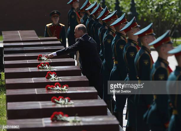 Russian President Vladimir Putin lays a wreath at the Unknown Soldier's Tomb on June 22, 2016 in Moscow, Russia. Russia is marking the 75-th...
