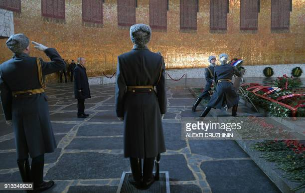 Russian President Vladimir Putin lays a wreath ceremony to the eternal flame at the Hall of Military Glory at the Mamayev Kurgan Memorial in...