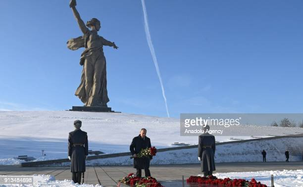 Russian President Vladimir Putin lays flowers at the grave of Soviet Marshal Vasily Chuikov at the Mamayev Kurgan memorial complex commemorating the...