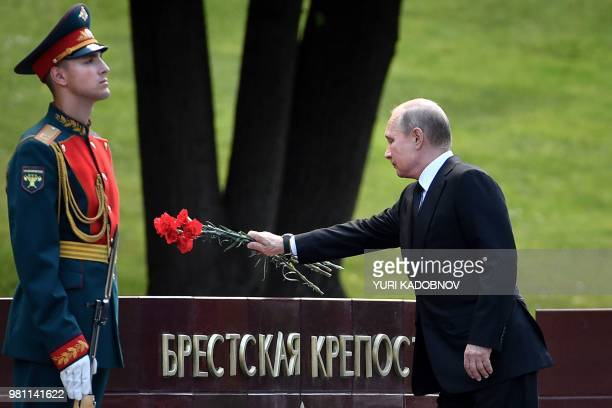 Russian President Vladimir Putin lays flowers during a ceremony marking the anniversary of the Nazi German invasion in 1941, at the Kremlin in Moscow...