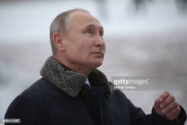 Russian President Vladimir Putin lays flowers on a monuments as he commemorates the 75th anniversary of the end of the Siege of Leningrad at...