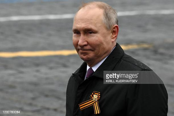 Russian President Vladimir Putin leaves Red Square after the Victory Day military parade in Moscow on May 9, 2021. - Russia celebrates the 76th...
