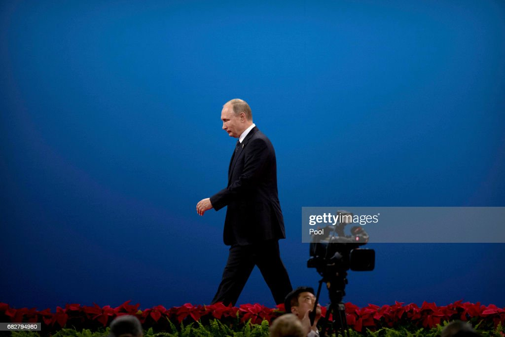 Russian President Vladimir Putin leaves the stage after speaking during the opening ceremony of the Belt and Road Forum at the China National Convention Center (CNCC) in Beijing, Sunday, May 14, 2017. The Belt and Road Forum focuses on the One Belt, One Road (OBOR) trade initiative.