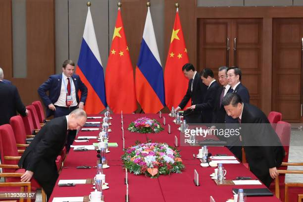Russian President Vladimir Putin left and Chinese President Xi Jinping right attend the meeting at Friendship palace on April 26 2019 in Beijing China
