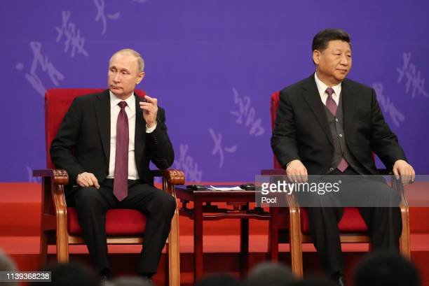 Russian President Vladimir Putin, left, and Chinese President Xi Jinping, right, attend the Tsinghua Universitys ceremony, at Friendship Palace on...